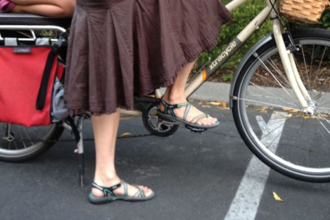 Sporty sandals are fine for the easy trips. For bigger loads on hillier routes, Cherie flips the pedals and clips in.
