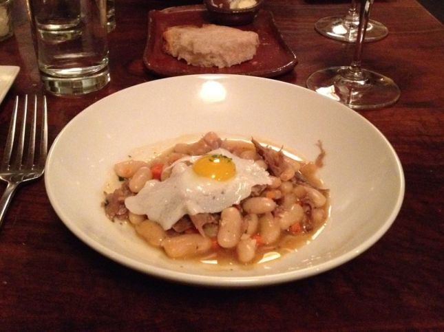 His 3rd course: White bean cassoulet topped with a quail egg.