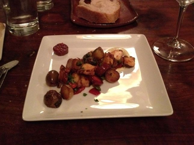 His 1st course: Octopus roasted with potatoes and peppers in a hearty Mediterranean style.