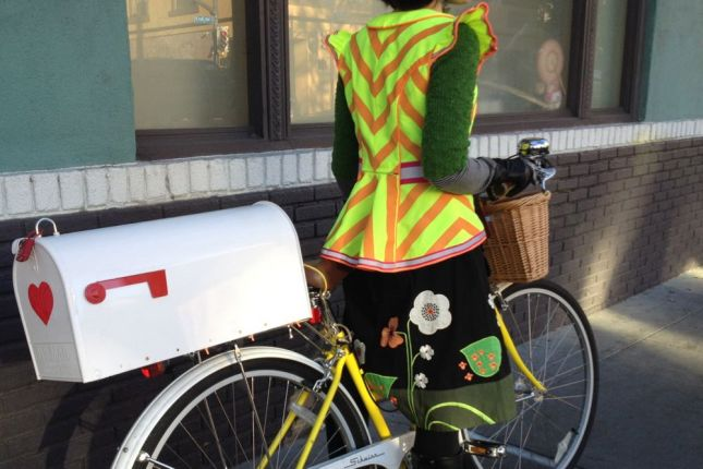 With a peplum waistline and chevron detailing, the fun (and visibility) doesn't end as Emma pedals away.