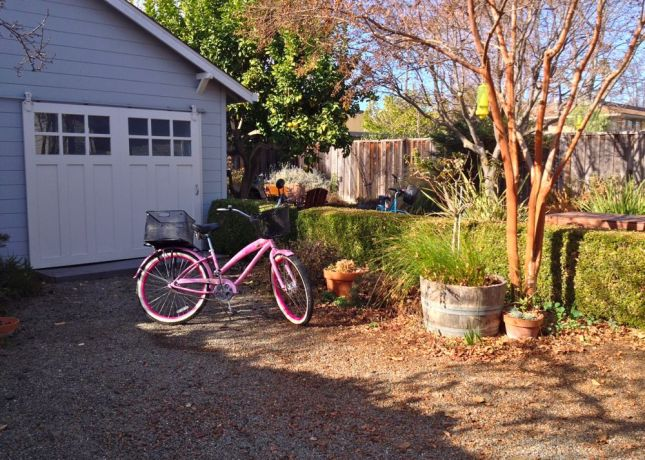 There's plenty of parking next to the back yard's lovely garden.