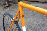Steel frame by SyCip with lugs by Richard Sachs in Eddy Merckx orange.