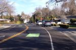 Same spot two years later. New sharrows, new stop sign.