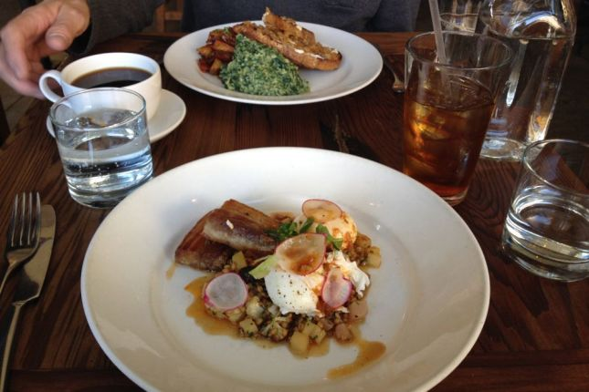 Nettle scramble for him, poached egg and pork belly over sprouted farro for me.