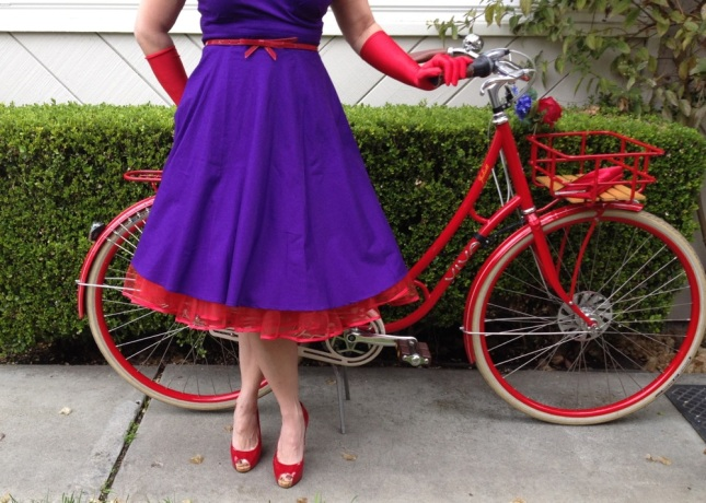 Layers and layers of tulle in a satin-edged petticoat give the dress'  full skirt a true fifties flair.
