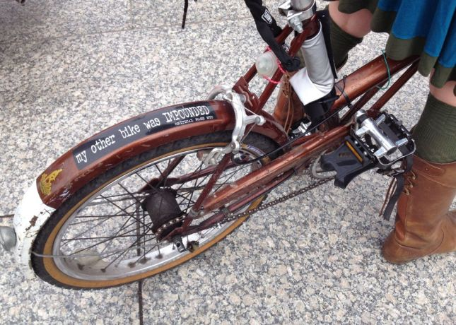 The bumper sticker was from a previous owner. Her other bike was stolen, not a Critical Mass casualty.