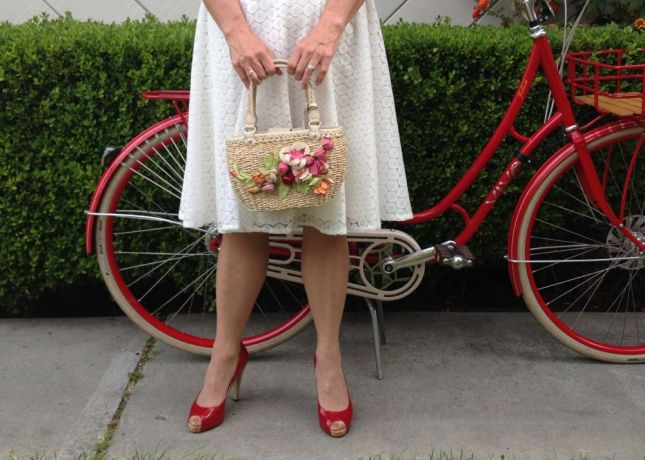 Nothing says summer like a straw bag adorned with leather flowers.